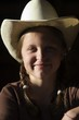 Girl In Cowboy Hat Smiling