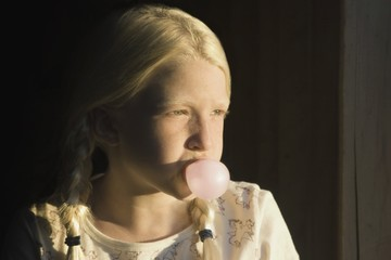 Girl Blowing A Bubble With Gum