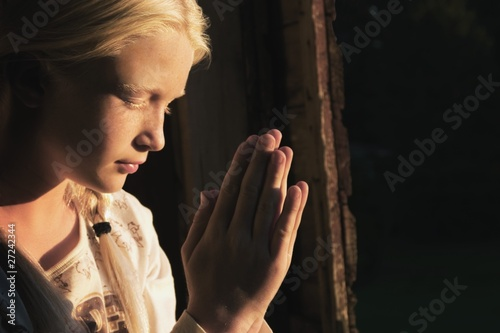 Girl Praying In The Dark