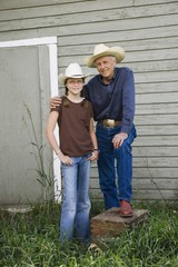 Grandfather And Granddaughter Wearing Cowboy Hats