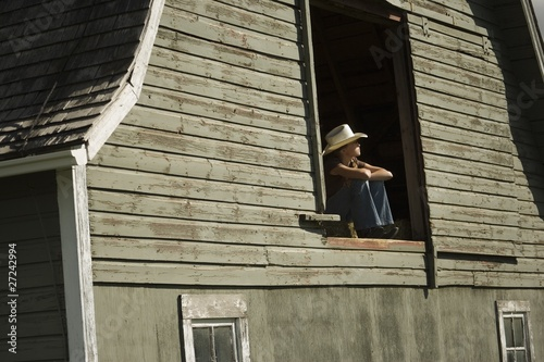 Young Woman In Barn Loft