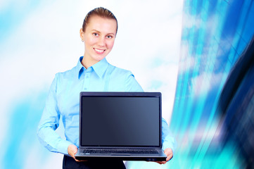 Happiness businesswoman with laptop on blur business architectur