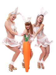 Three girls in suits of a hare with a different carrot