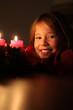 Leinwandbild Motiv Mädchen vor Adventskranz
