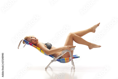 Woman relaxing in beach chair