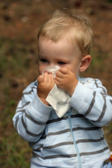 Blowing, nose - baby boy with tissue and catarrh or allergy