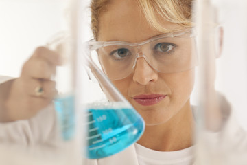 Close-up of scientist holding beaker