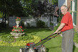 Senior Citizen Mowing Lawn
