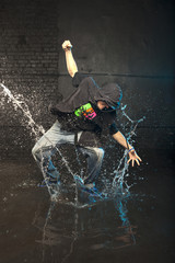 Hip-hop dancer in aqua studio