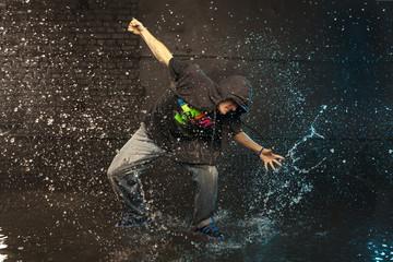 Hip-hop dancer in aqua studio