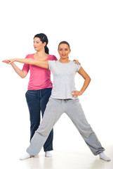 Personal trainer assist woman at fitness