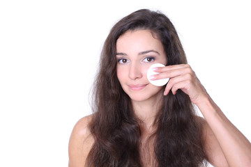 Cleansing face with lotion - woman with cotton pads isolated on