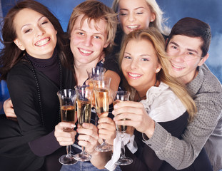 Group young people drinking champagn at nightclub.