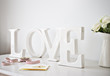 """wooden """"love"""" letters decoration, ribbon and cards on desk"""