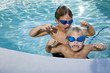Summer fun, boys playing in swimming pool