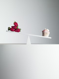 cupcake tipping seesaw with strawberries on opposite end