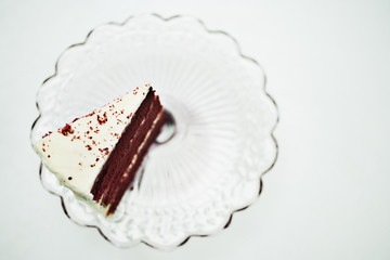 slice of chocolate cake on cakestand
