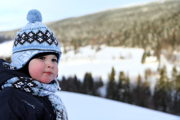 portrait small boy in winter on mountains Krkonose