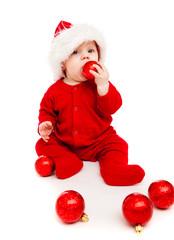Baby with Christmas balls