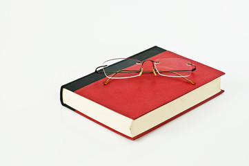 Glasses on red book