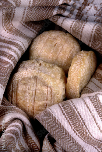 Mature french goats cheese wrapped in a cloth