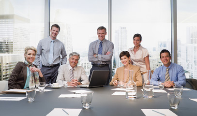 smiling business people in conference room overlooking city