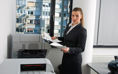 business woman next to office printer