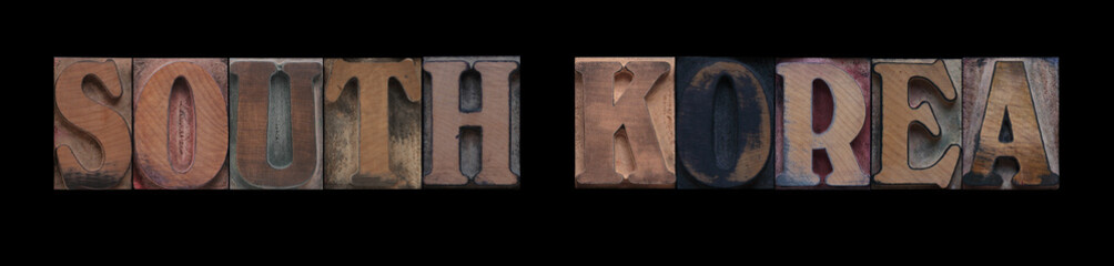 the words South Korea in old letterpress wood type