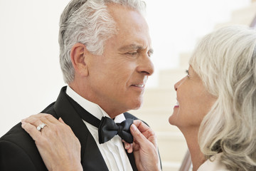 well-dressed senior couple face to face