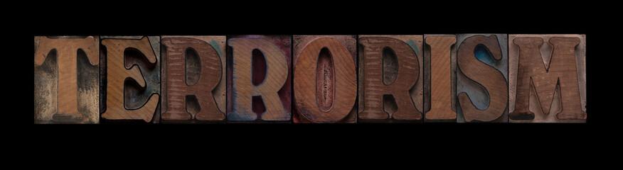 the word terrorism in old letterpress wood type