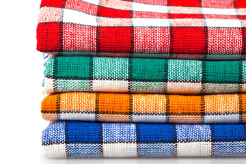 Four colored dishcloths isolated