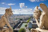 Fototapety Famous gargoyles of Notre Dame overlooking Paris (compos)