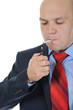 Businessman in black suit holding a cigarette