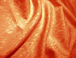 Soft silk in glowing orange