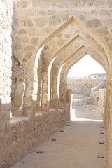 Curved masonry construction passage inside Bahrain fort