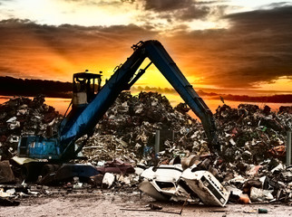 Car recycling to the dump.Dramatically scene at the sunset.