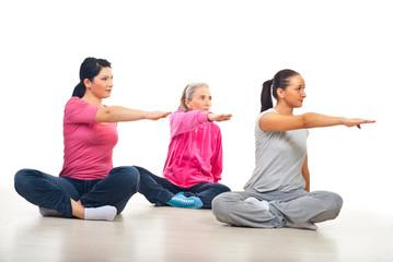 Three women stretching hands