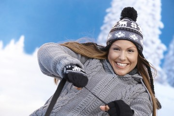 Young female having winter fun smiling
