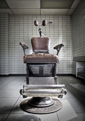 An old anxious dentist chair at an abandoned hospital