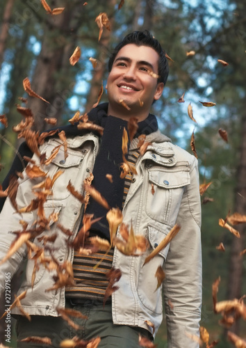 Young happy men walk in park, autumn day