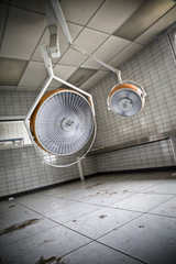 The surgical lamps of a surgery room at an abandoned hospital.