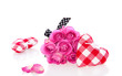 pink roses and decorative checkered hearts isolated on white bac