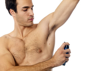 Young Man Applying Deodorant. Model Released