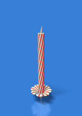 Unlit red stripes candle