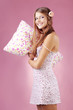 Girl holding pillow