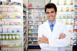 portrait of a male pharmacist at pharmacy - 27313303