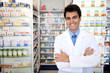 Leinwanddruck Bild - portrait of a male pharmacist at pharmacy