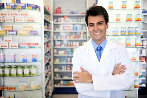 Leinwanddruck Bild portrait of a male pharmacist at pharmacy