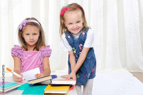 Little girls are studying literature