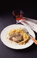 Steak with pepper sauce and french fries